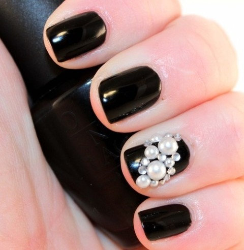 I like having one pearl nail as an accent. Also the white on black is so pretty. | Nails | Pinterest